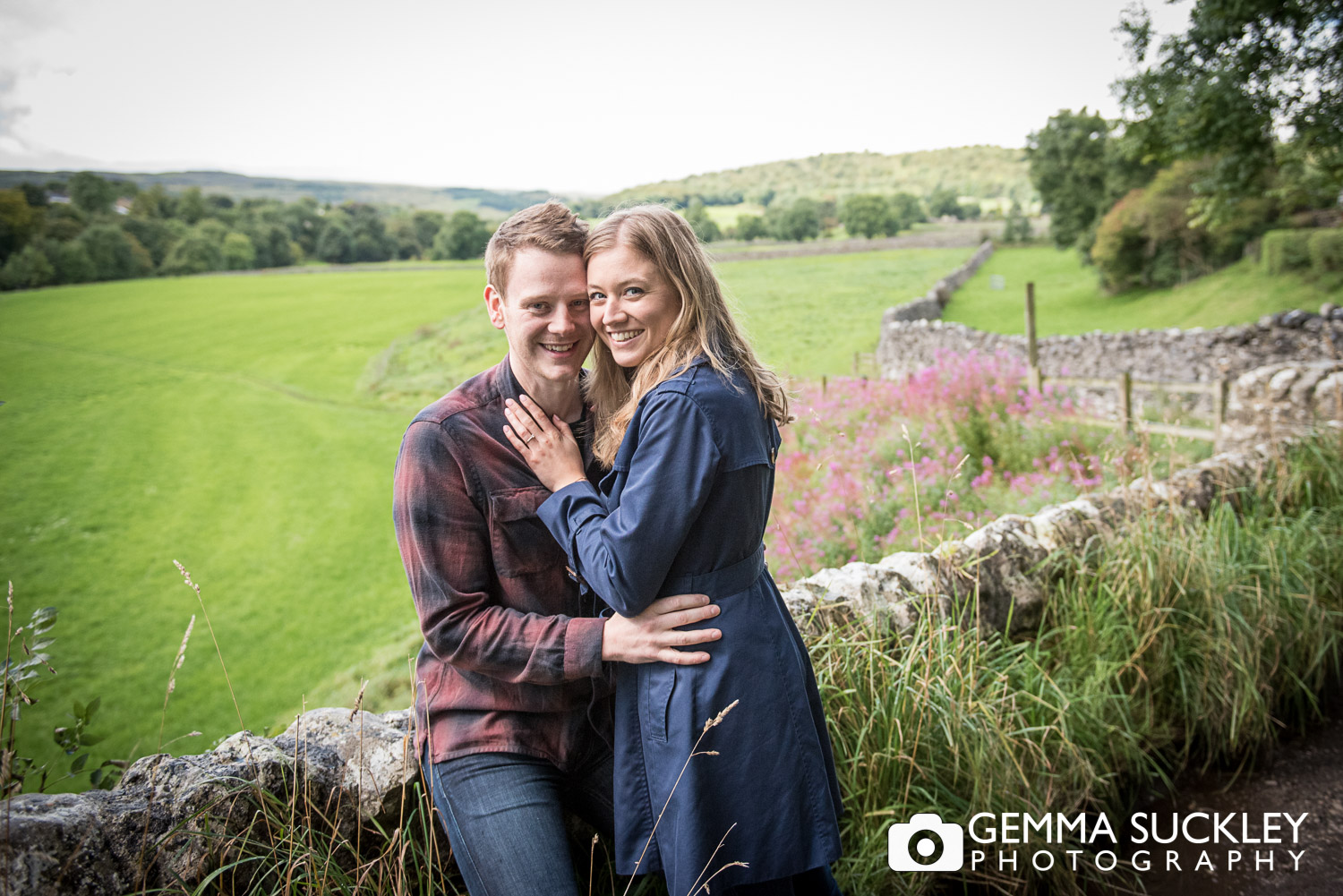 a Couple smiling during their pre-wedding photo shoot in Grassington