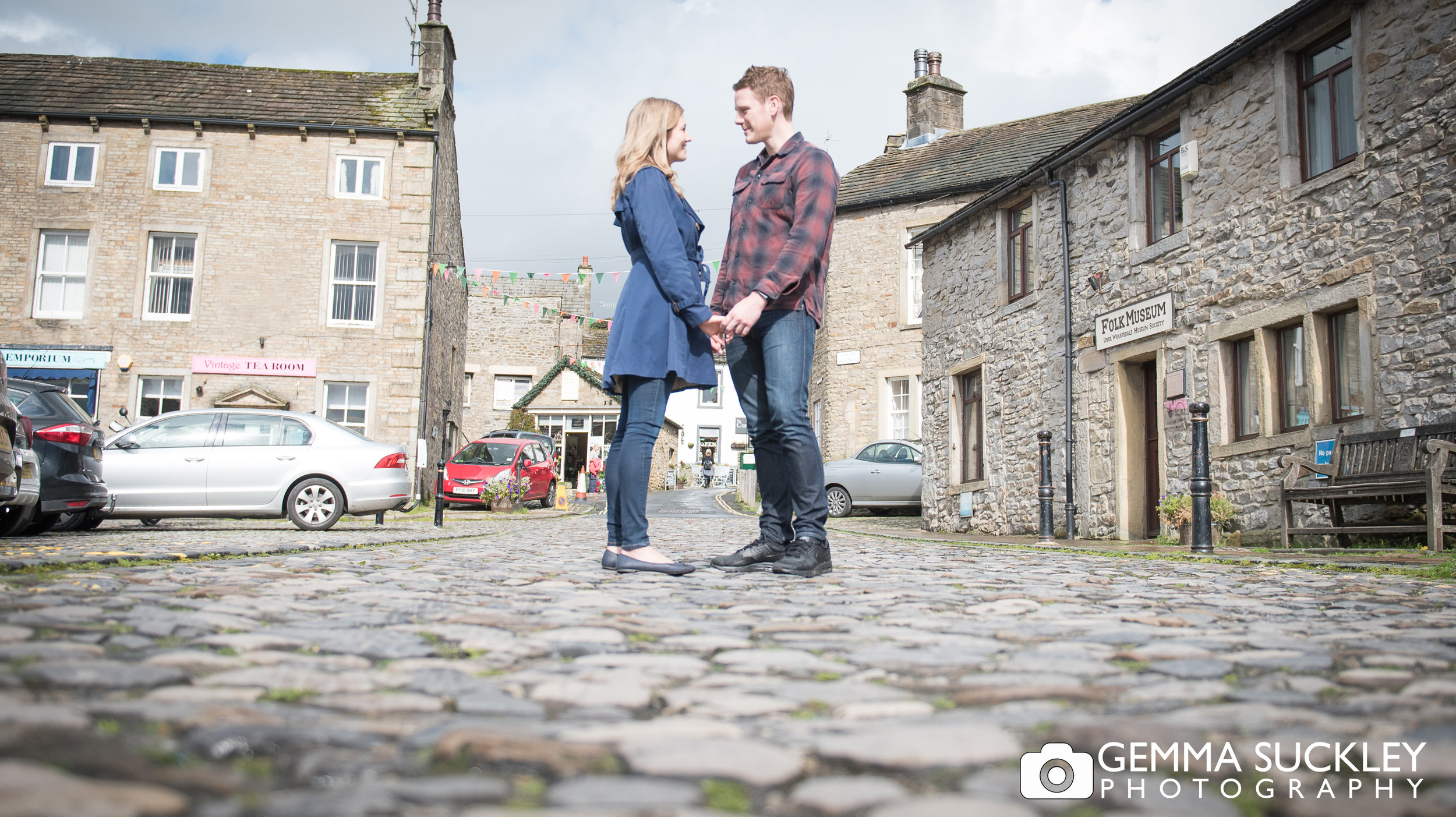 Couple holding hands in Grassington