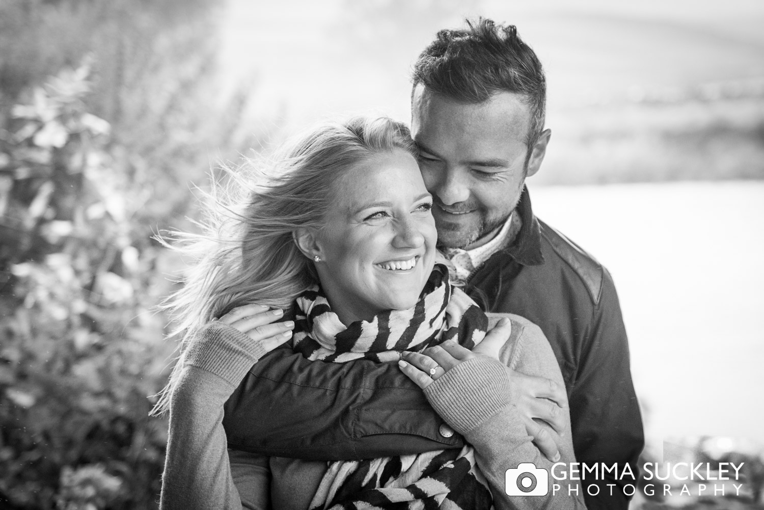 black and white photo of a couple during their pre-wedding photo shoot in burnsall