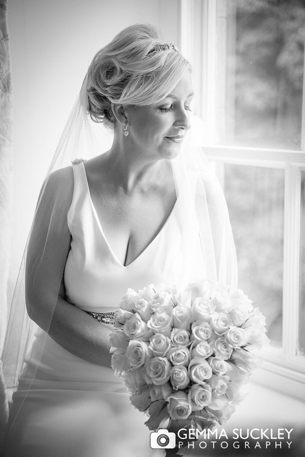 bride with flower at belmount hall