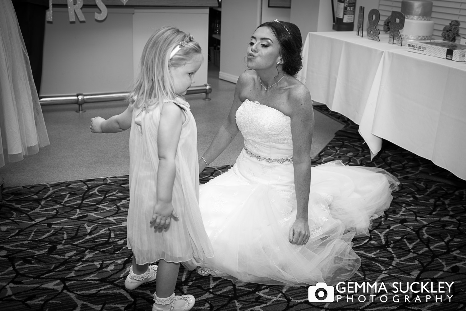 bride kissing the flower girl at st ives in bingley