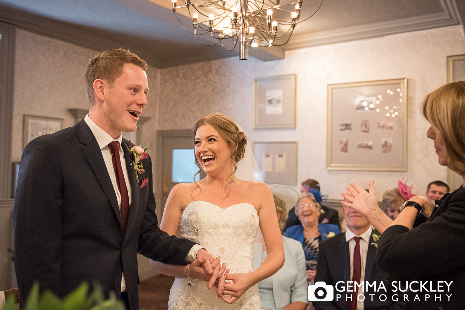 bride and groom laughing during their ceremony at grassington house