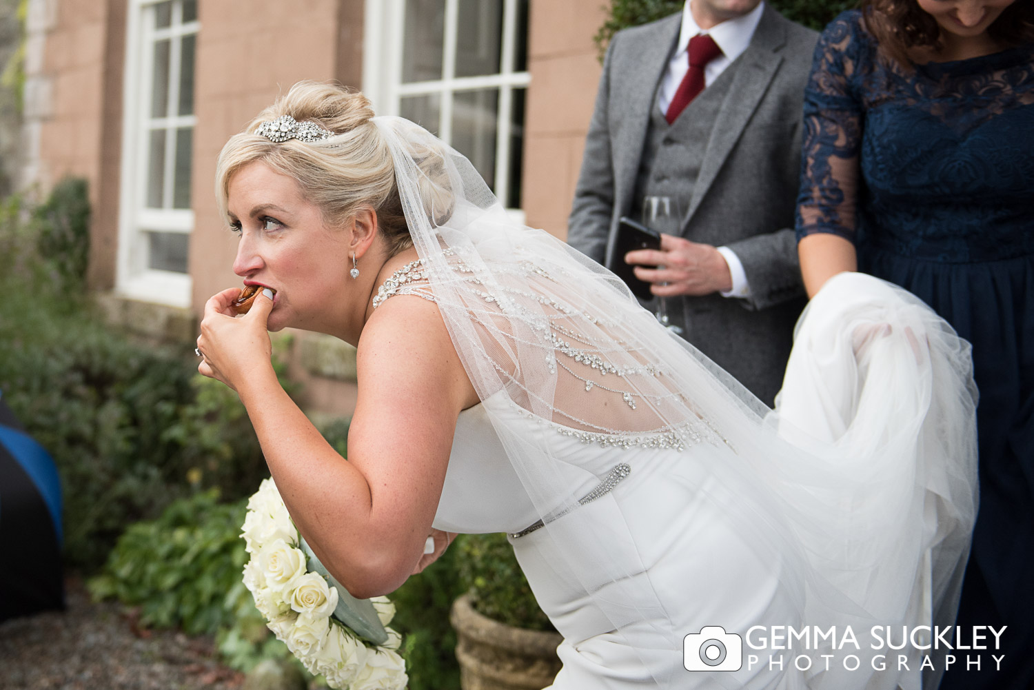 bride eating canepes at belmount hall