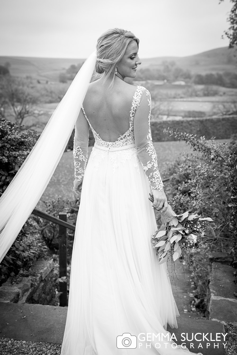 bride in her wedding dress at the devonshire fell in burnsall
