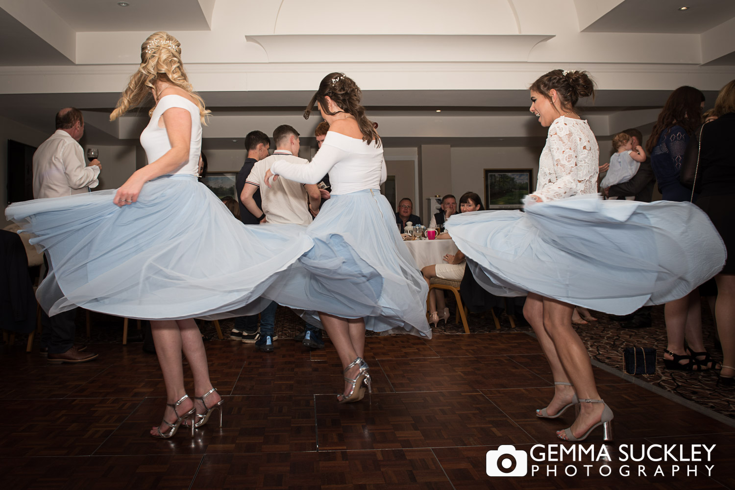 bridesmaid spinning round at st ives in bingley