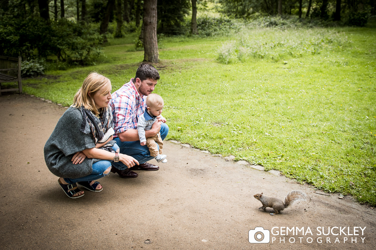 couple feeding a squirreal in golden acre park leeds