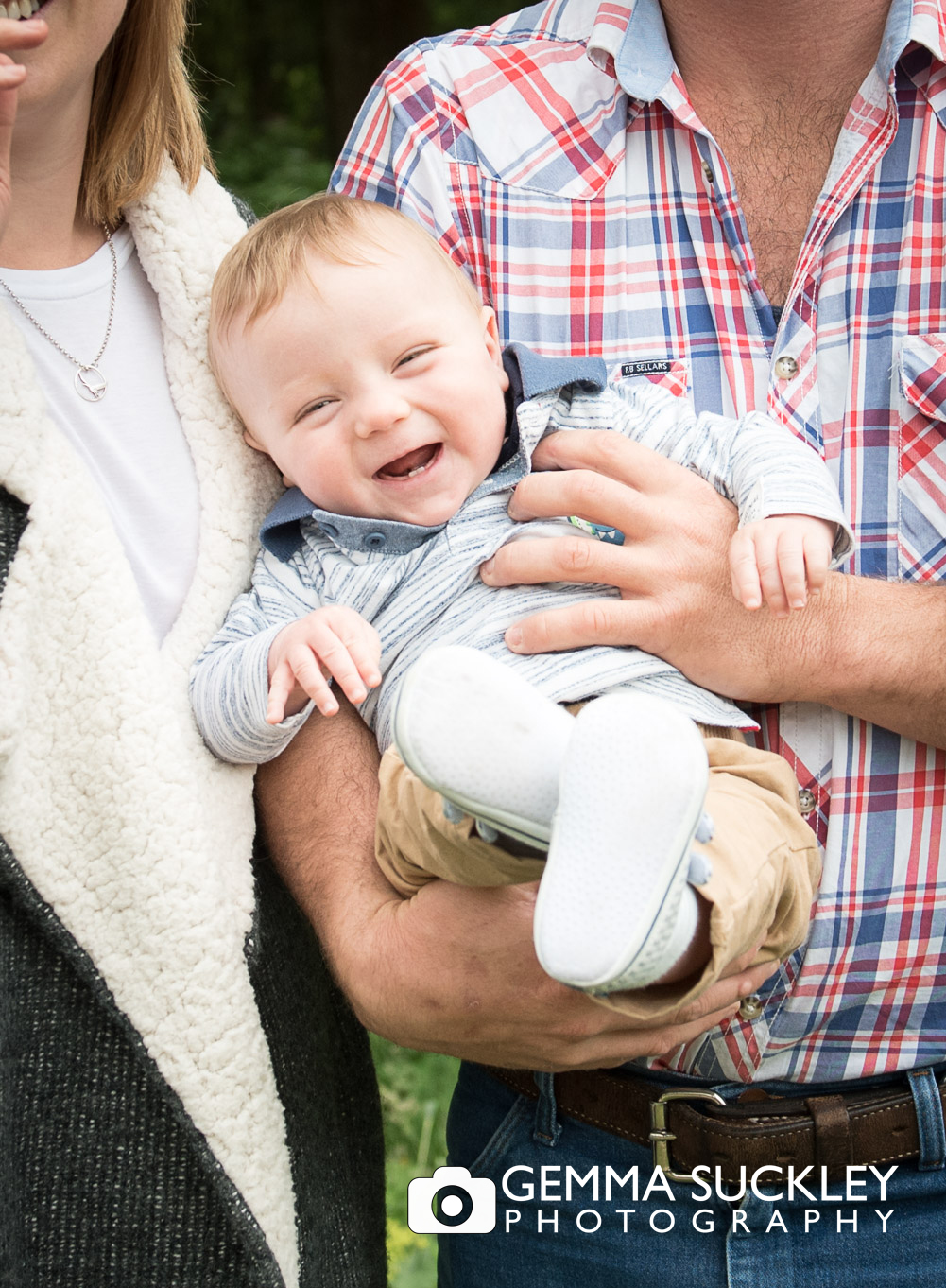 baby boy laughing during a photo shoot