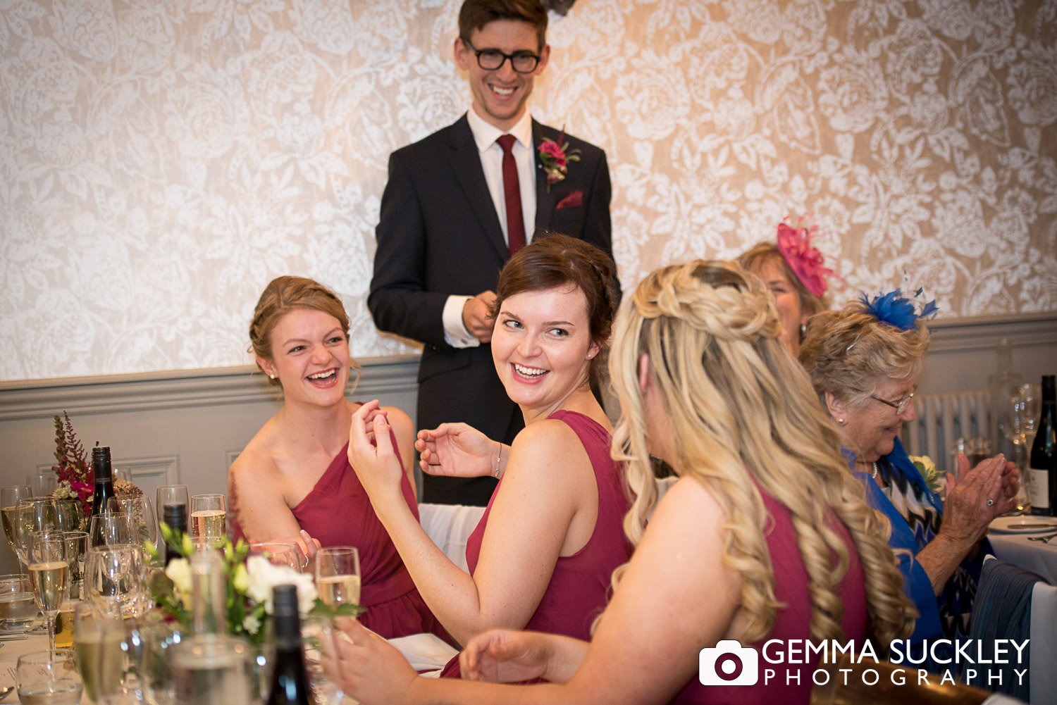 bridesmaids laughing during grooms speech at grassington house