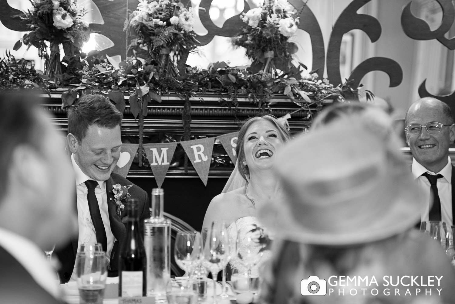 bride laughing during speeches at grassington house wedding