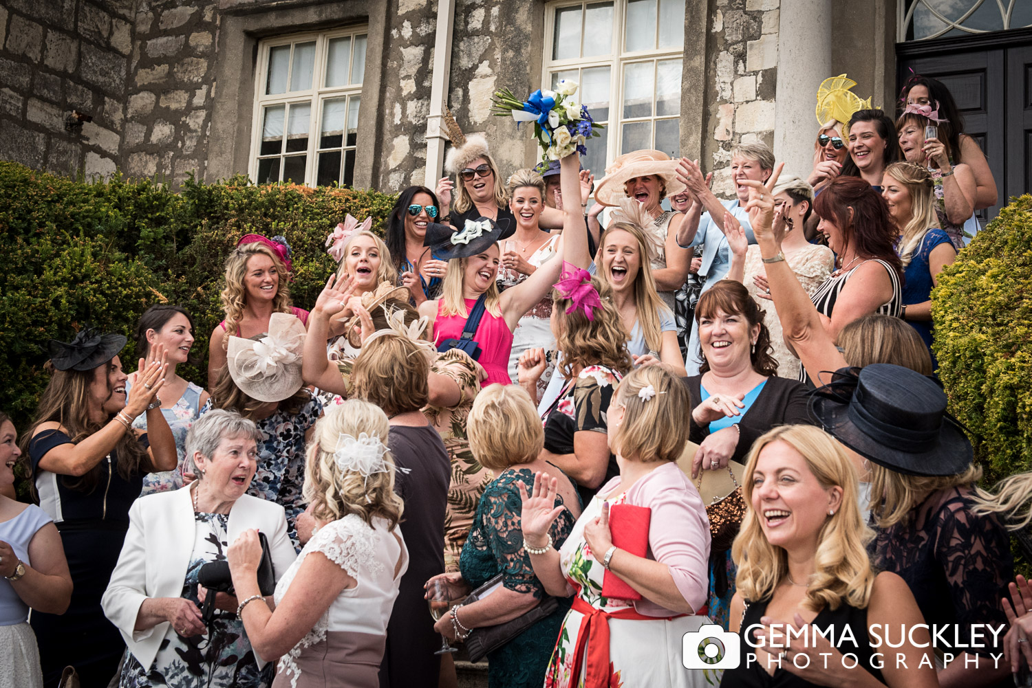 lady catching the wedding bouquet at hazlewood castle