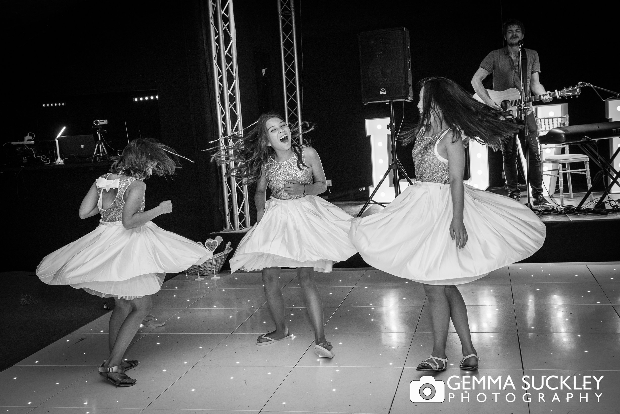 flower girls spinning so their dress blows out
