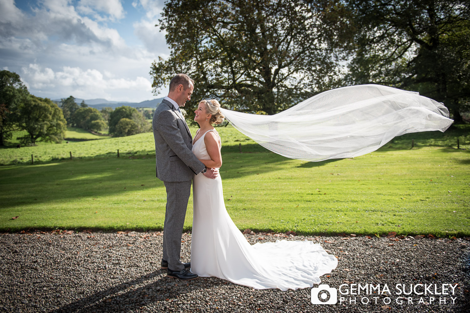 brides veil blowing in the wind at belmount hall wedding