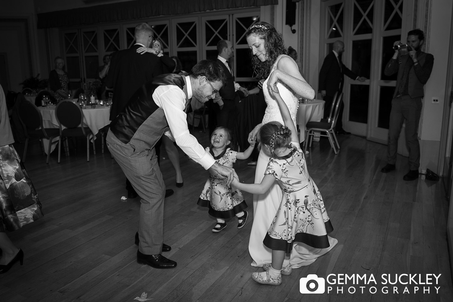 bride and groom dancing with flower girls at the sun pavillion