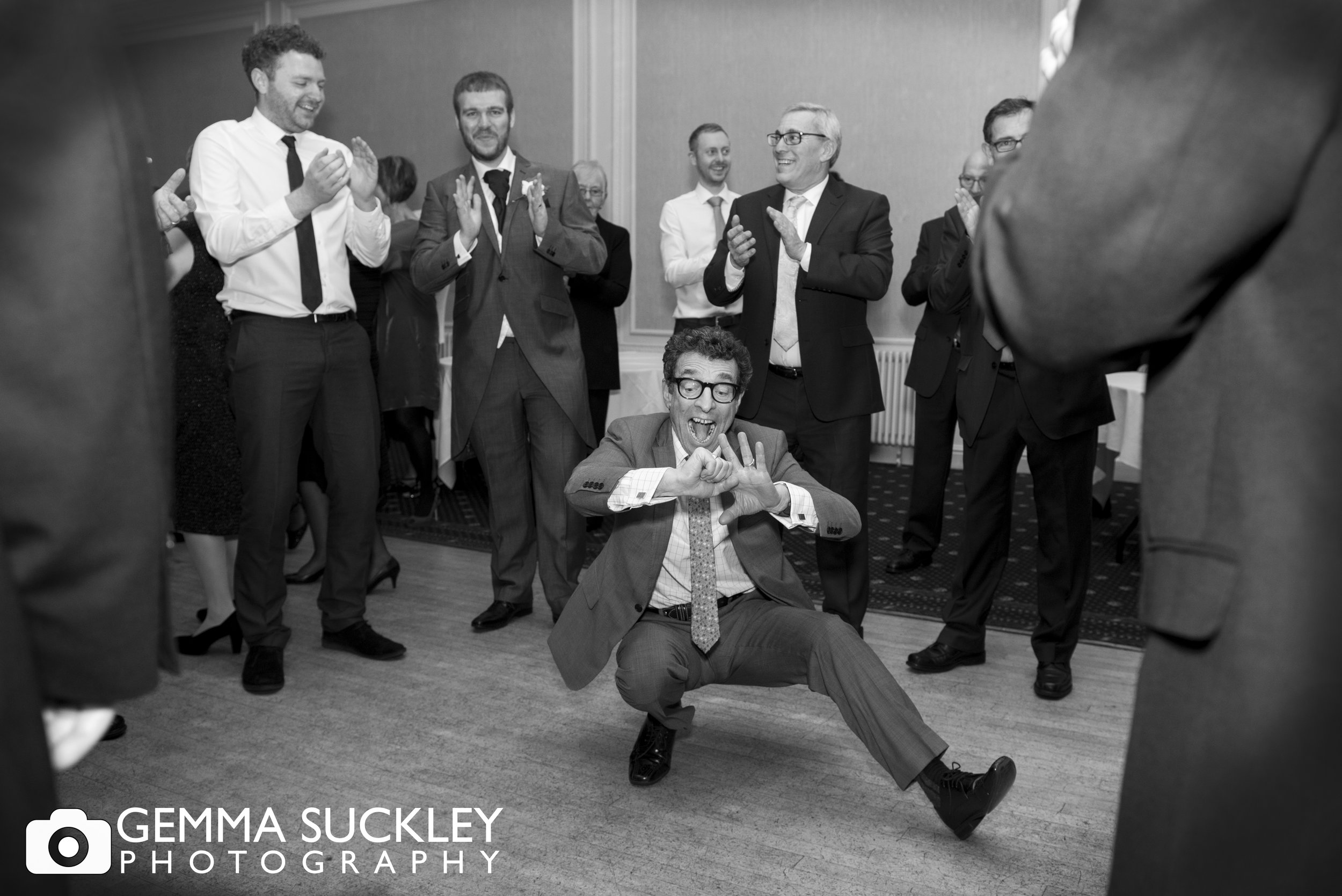 man dancing on the floor at a jewish wedding at the swan hotel in harrogate