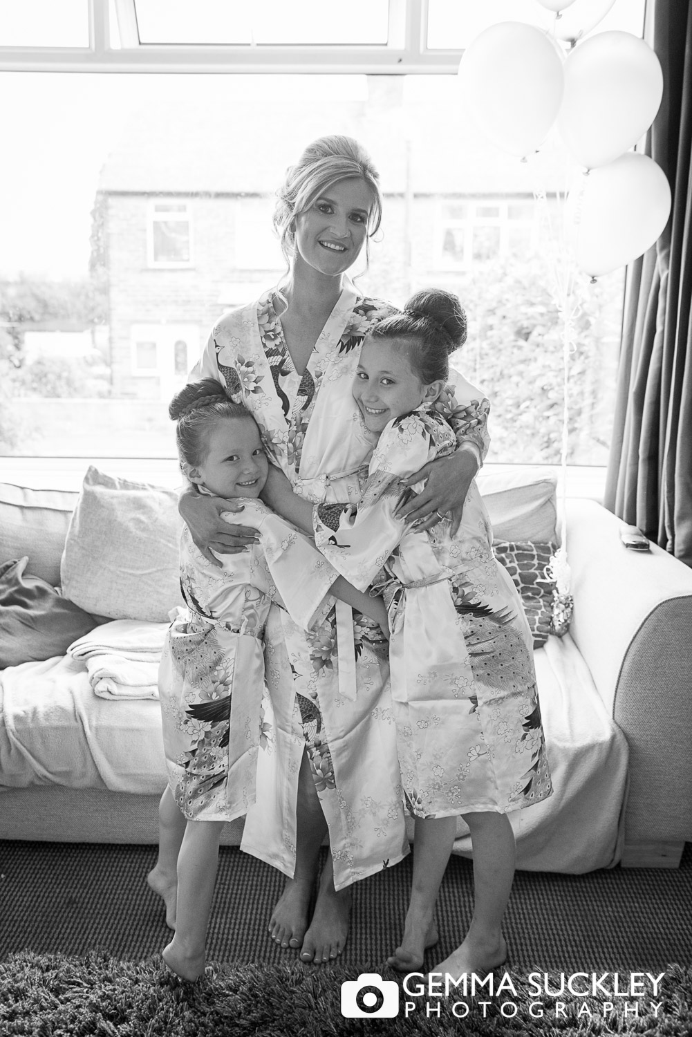 bride with her two daughters getting ready for her wedding