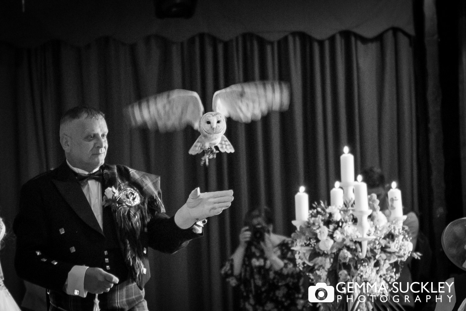 owl flying to the groom during the wedding ceremony