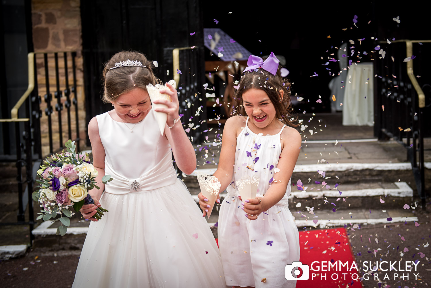 flower girls throwing confetti at park hall hotel