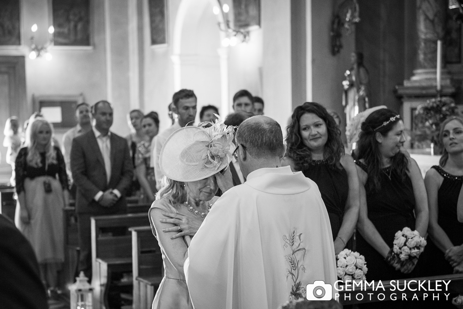 priest blessing the wedding guest