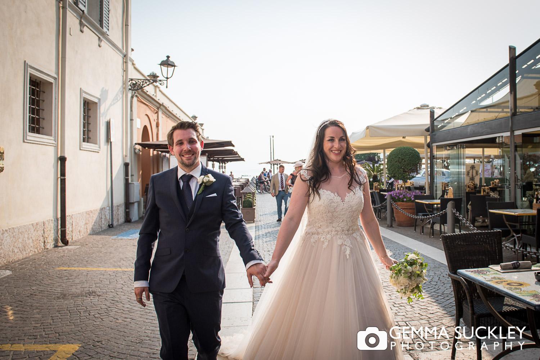 bride and groom walking in Bardolio, Lake Garda