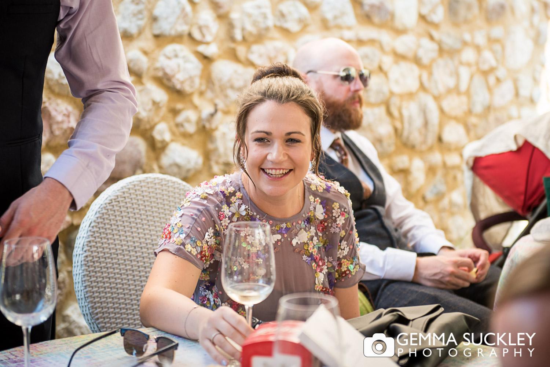 smiling wedding guest in lake Garda