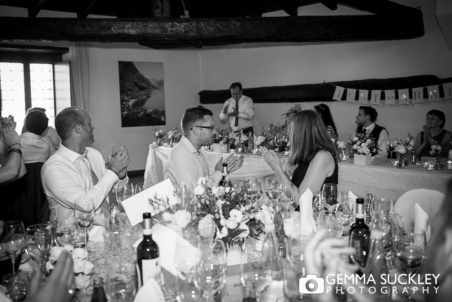 wedding guests applauding father of the bride sppech