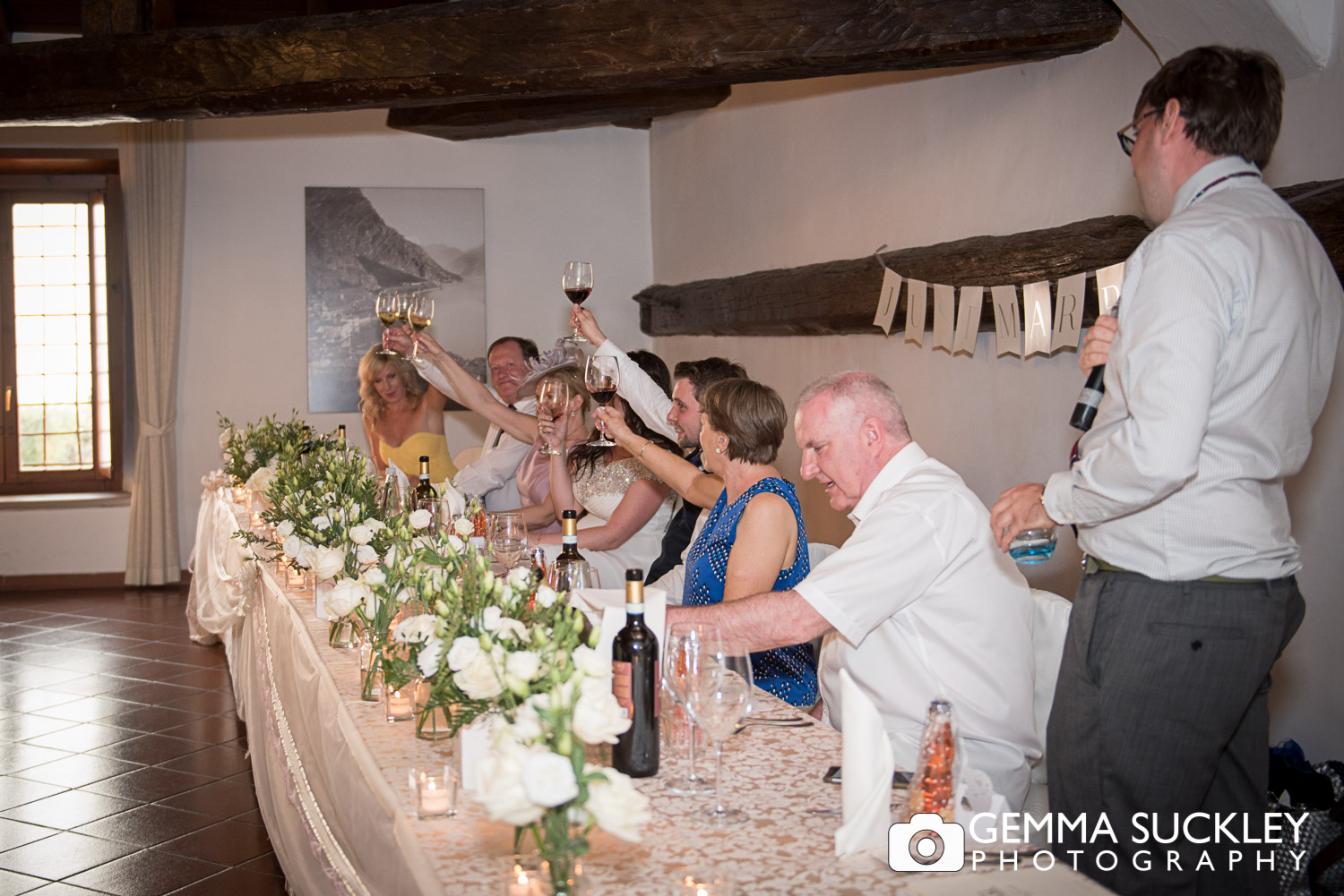 wedding guests toasting the bride and groom