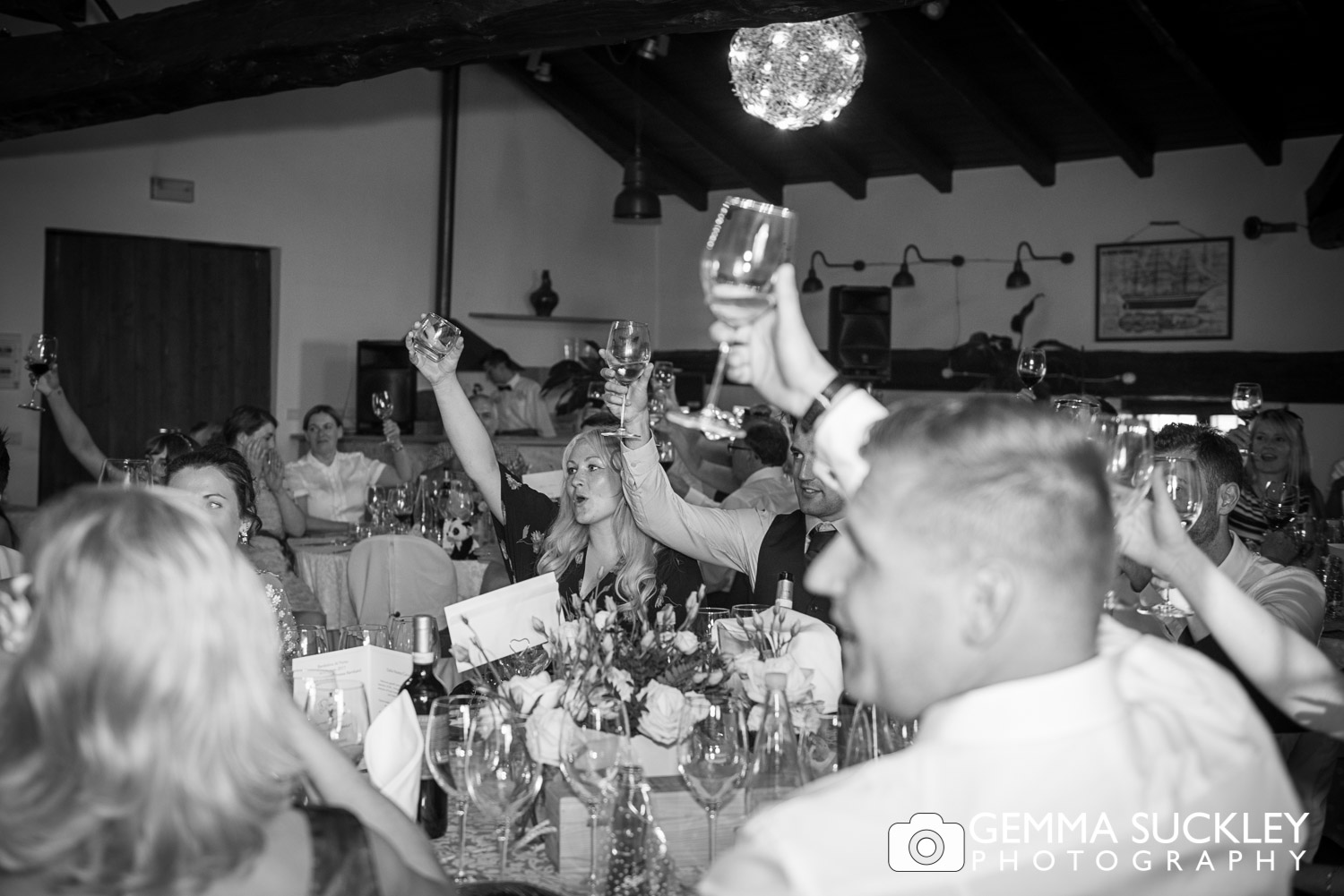 Wedding guest toasting the bride and groom during speeches