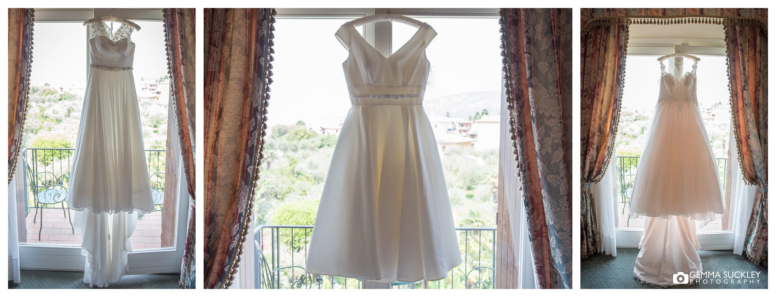 three wedding dresses hanging