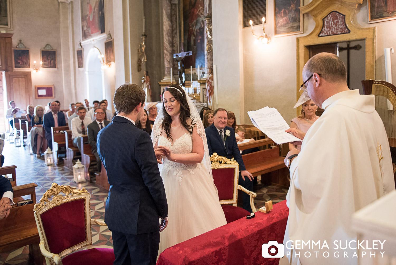 Yorkshire bride and groom exchanging rings, lake garda wedding