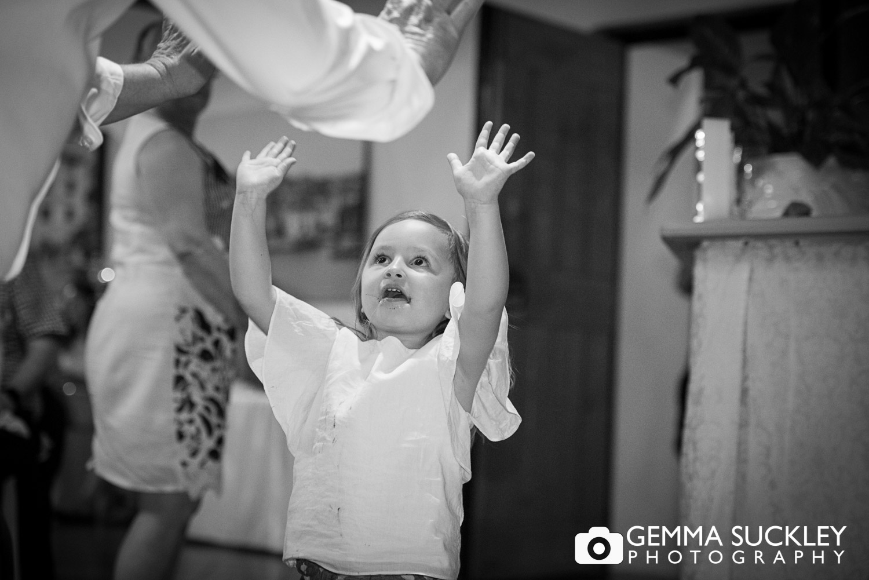 little girl dancing at wedding reception