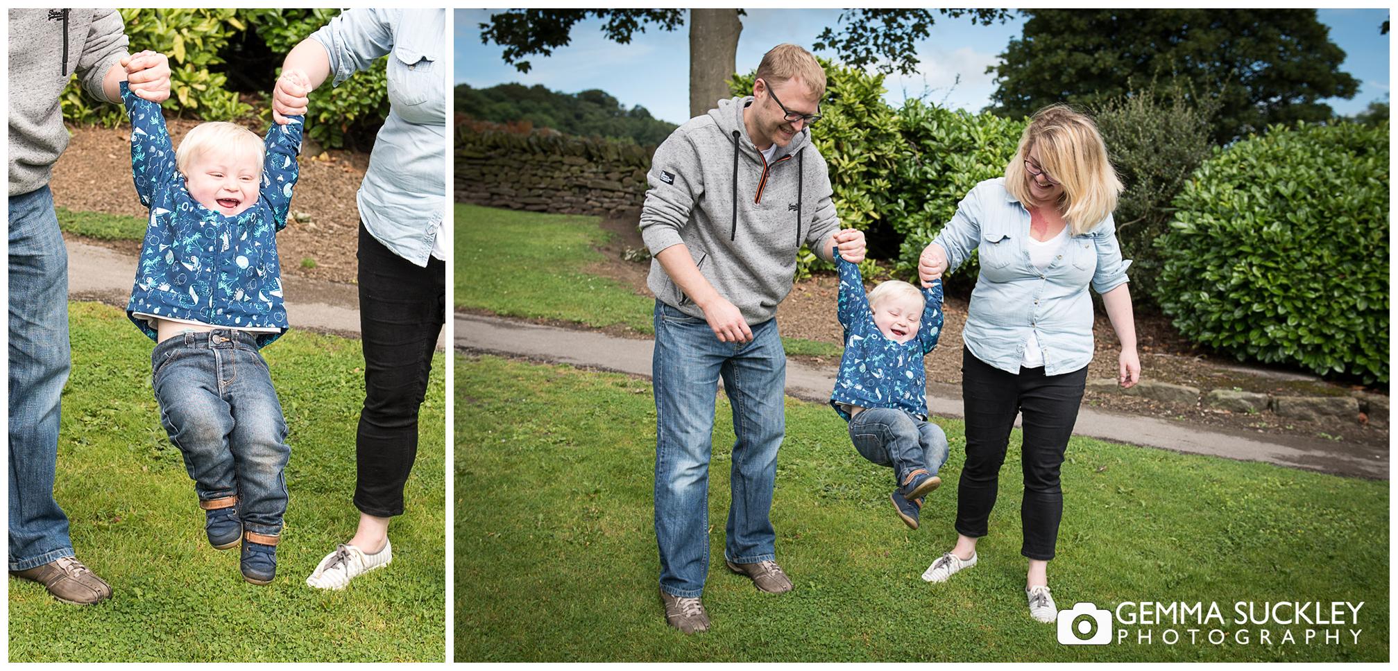 parents swing their little boy in Glusburn Park