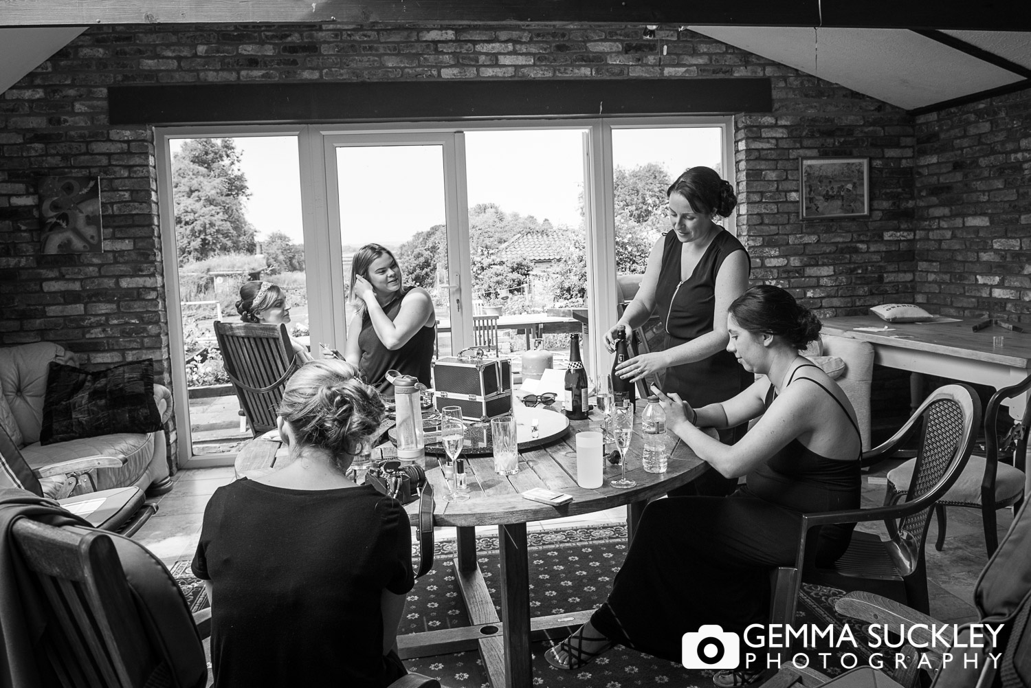 bridesmaids and bride getting ready for her wedding in Hutton