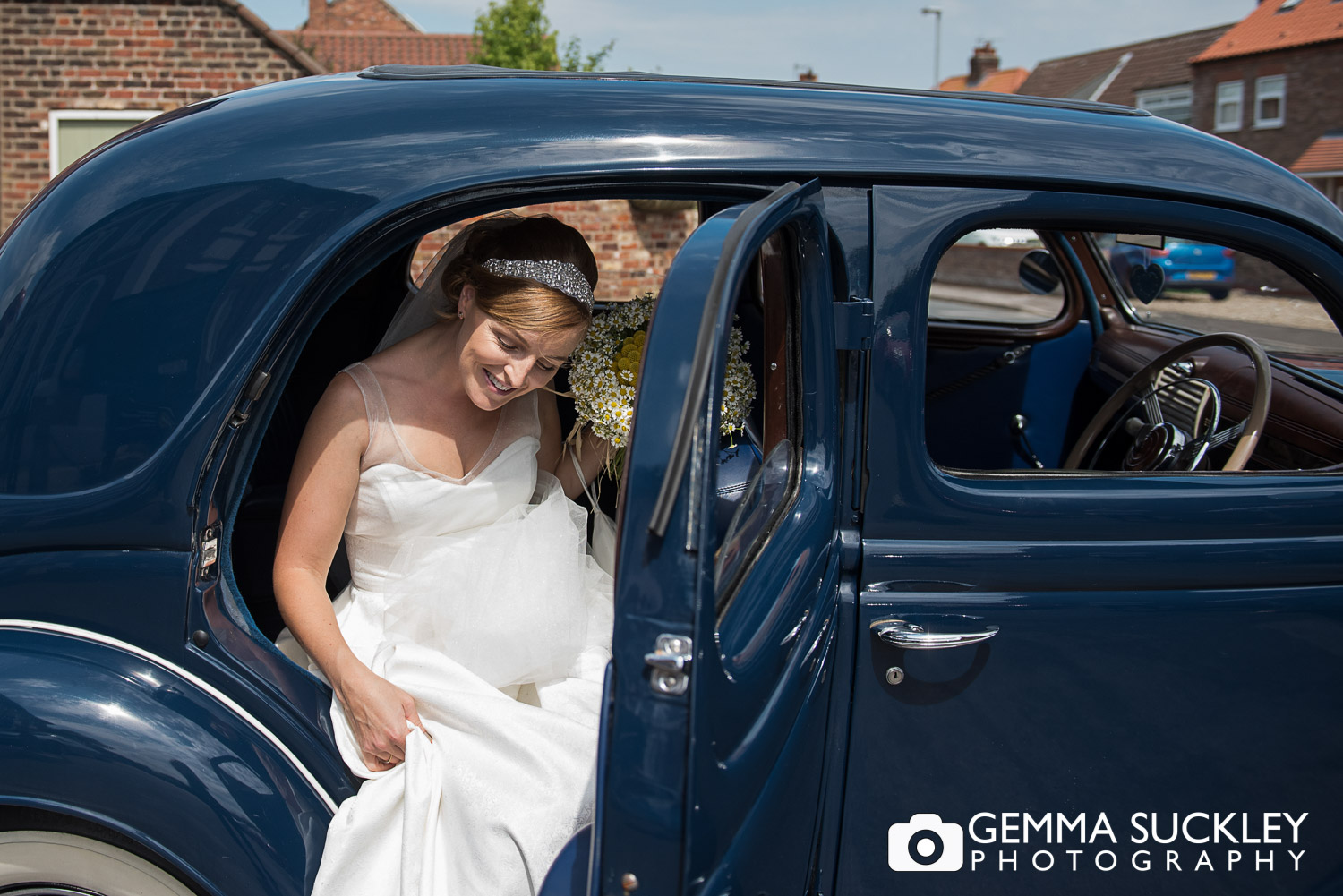 Bride getting out of the car for her wedding in Driffield