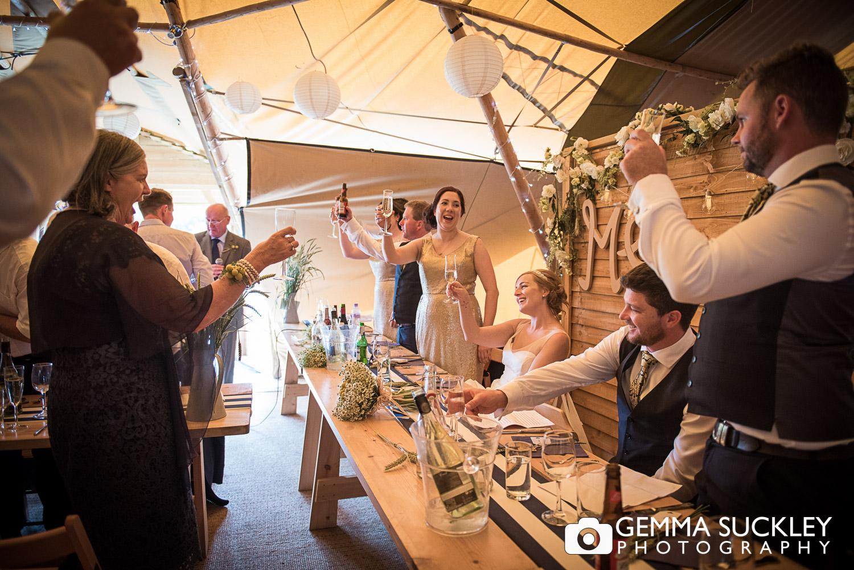 wedding guests during oaklands tipi wedding