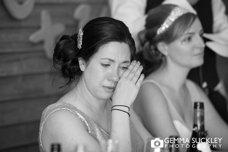 bridesmaid crying at speech at Oaklands