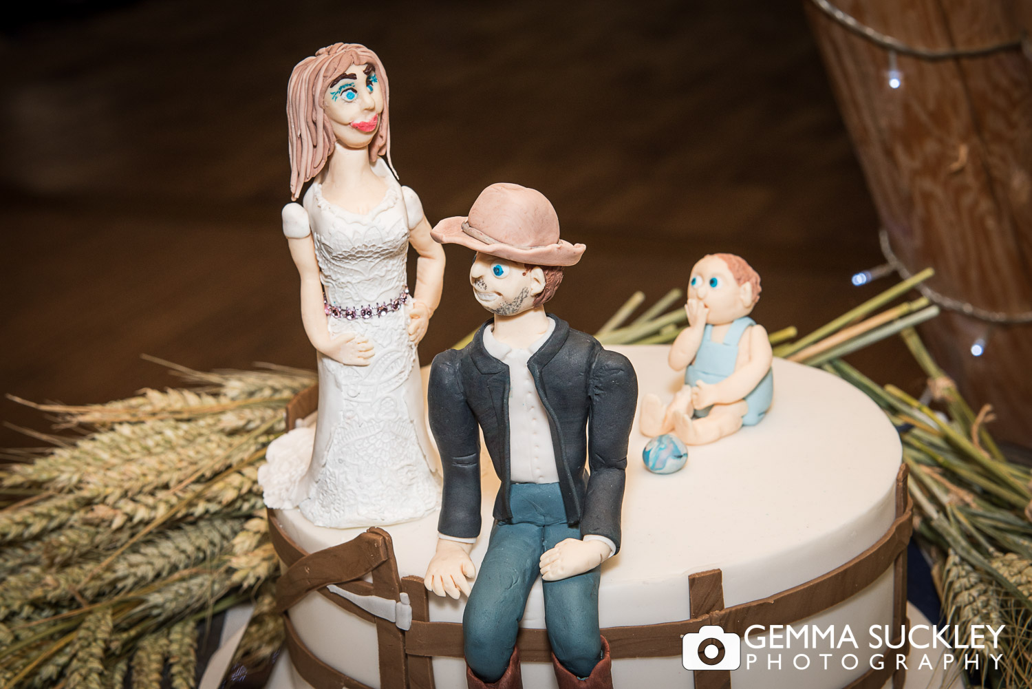 themed wedding cake of bride and groom