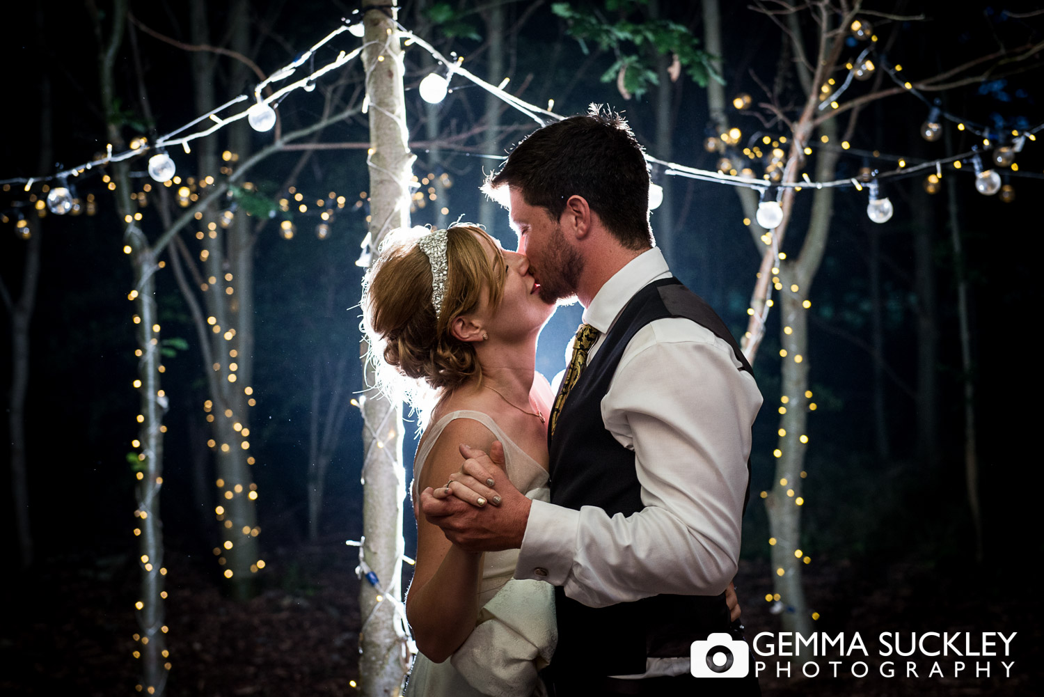 couple kissing at their woodland wedding at Oaklands, east Yorkshire