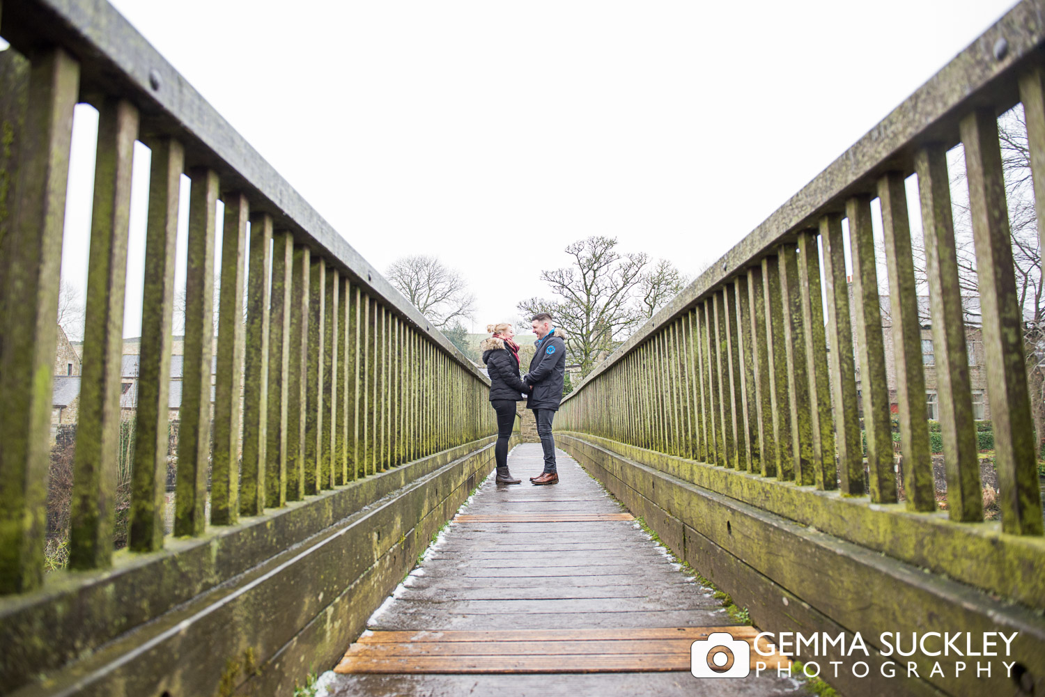 Couple standing on the bridge at Linton Falls during their engagement photo shoot