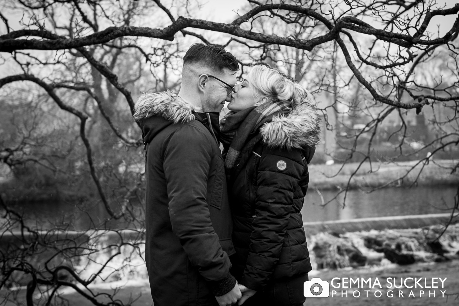bride and groom to be kissing in Grassington