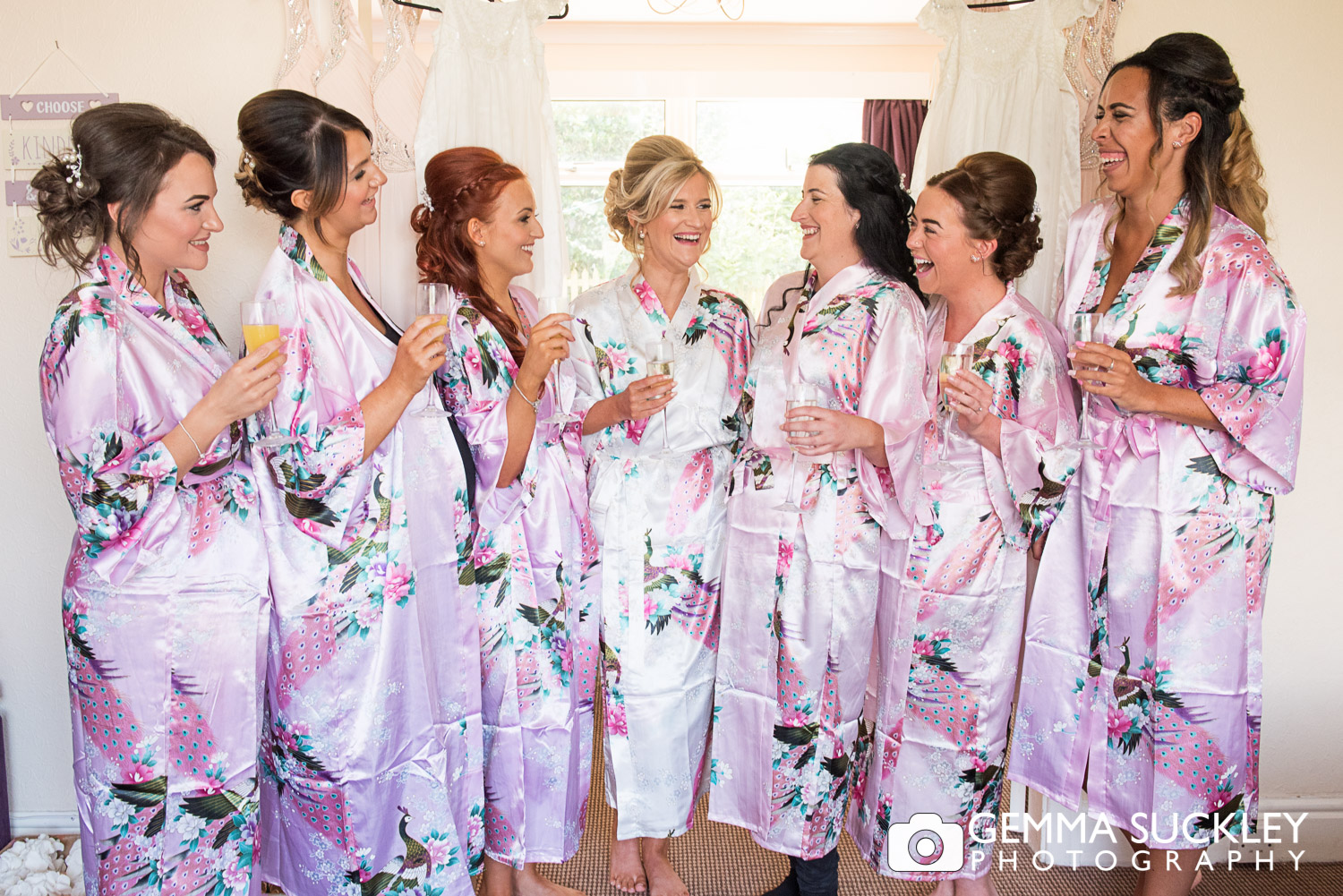 bridesmaids in matching dressing gowns
