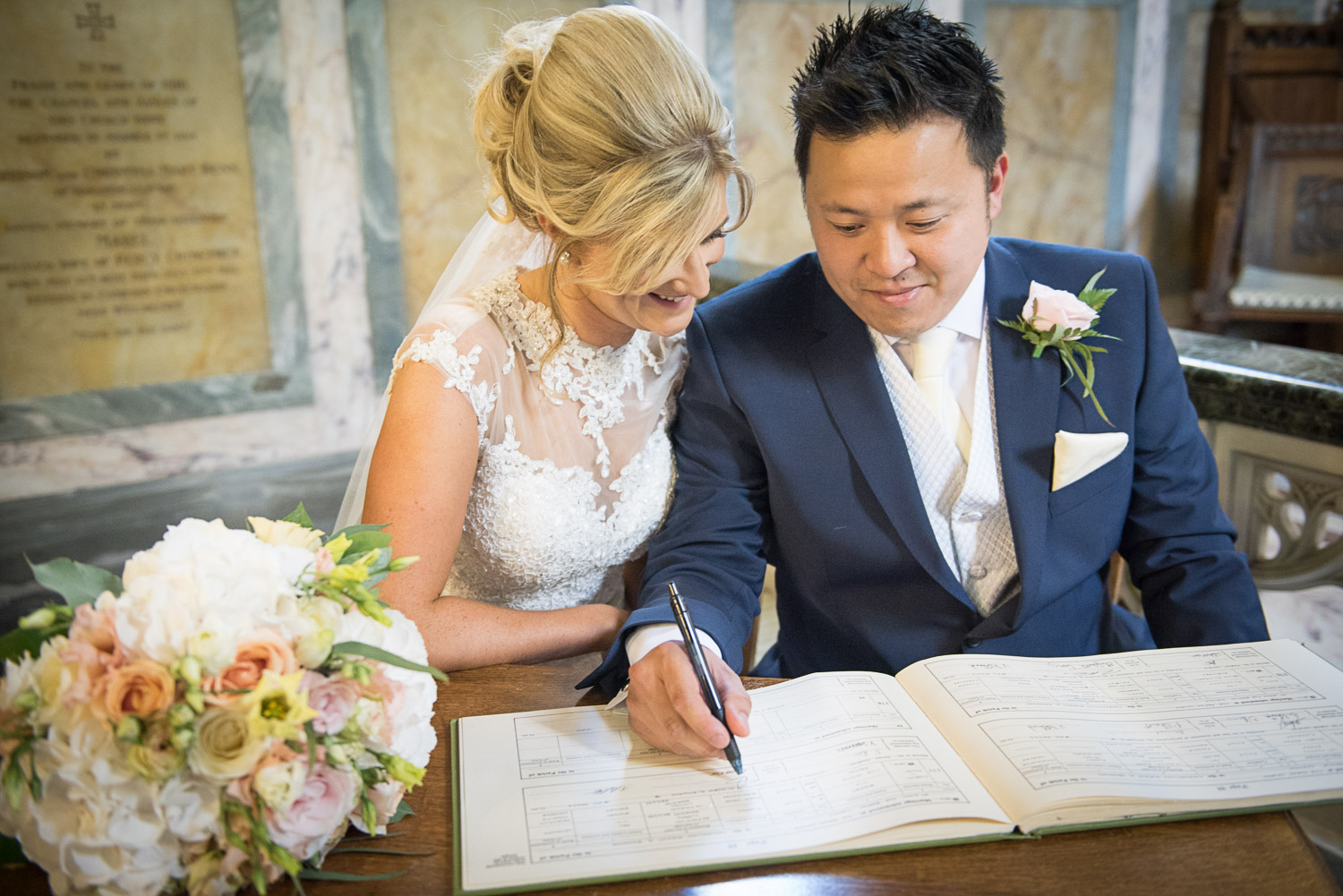 wedding photography of sign the register at St John's Church. Clayton