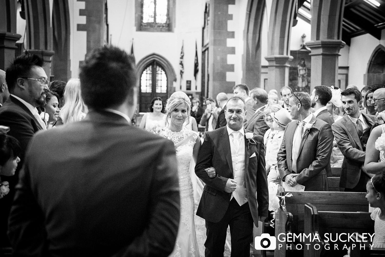 Bride walking down the aisle at St John's church in Clayton