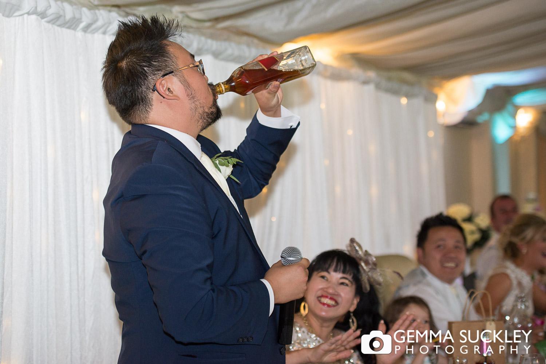 Best man drink whiskey during his speech at Moorlands Inn wedding