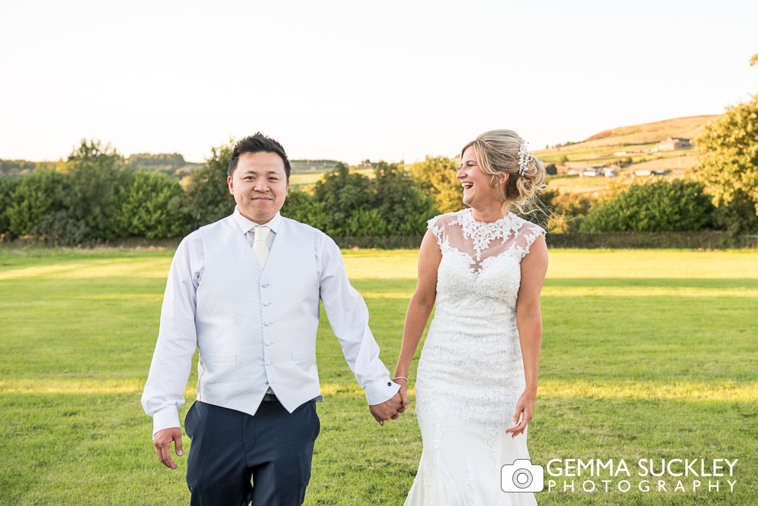 Bride and groom at golden hour in the field outside The Moorlands Inn