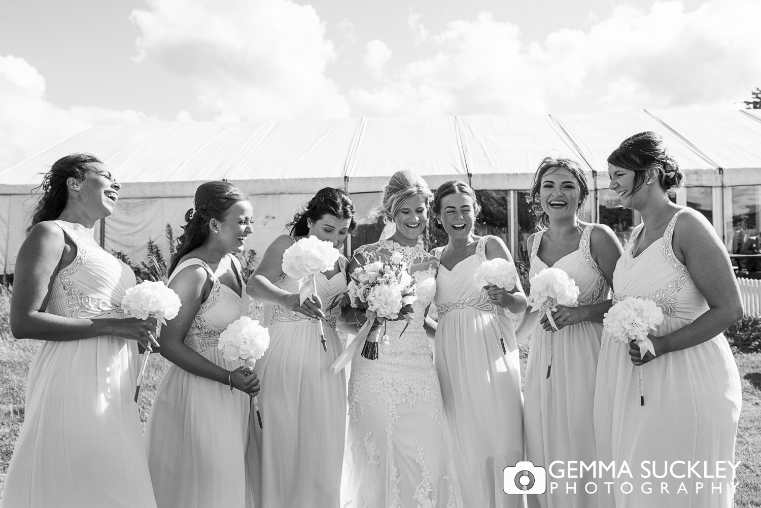 bride with bridesmaid laughing at The Moorlands Inn wedding
