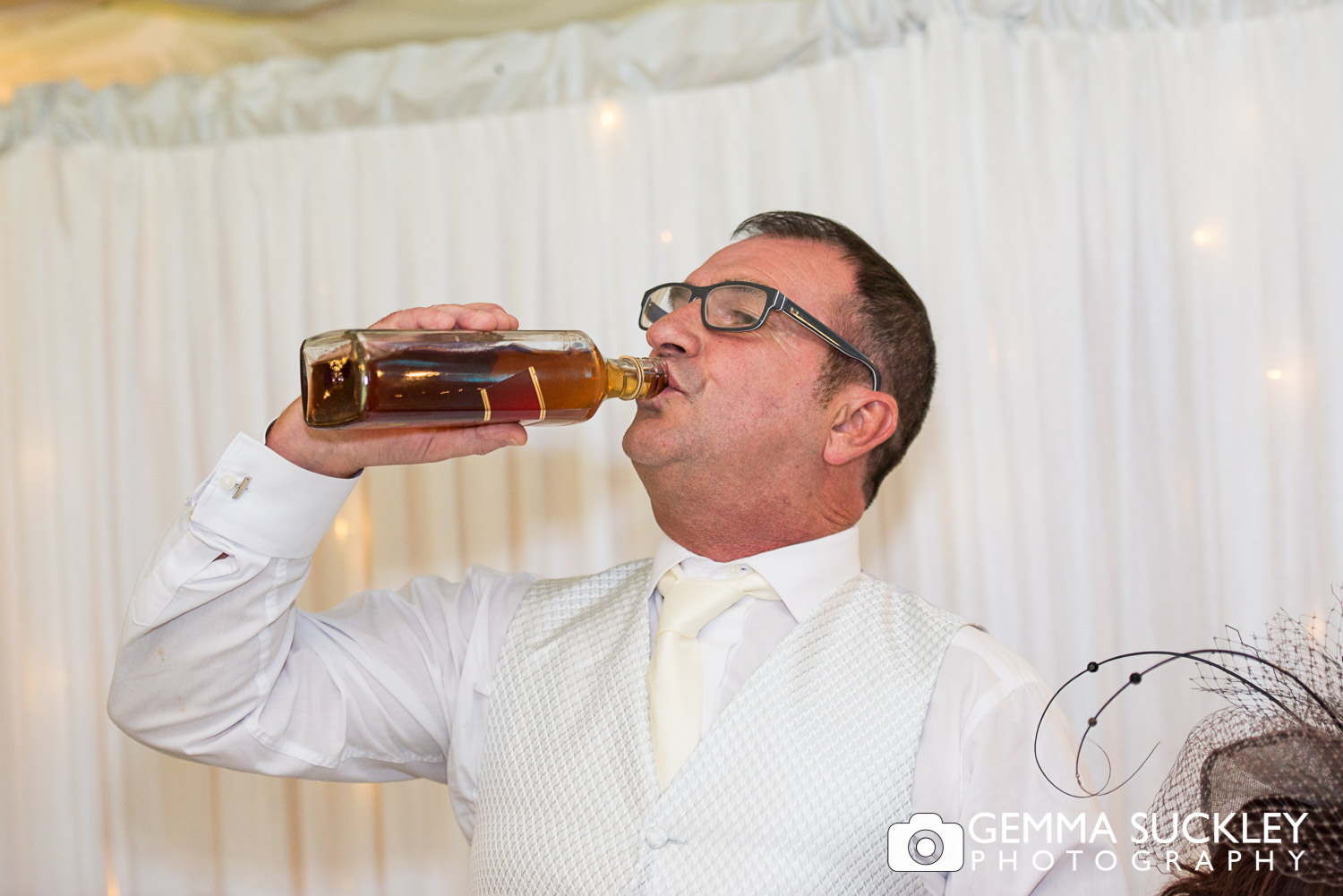 Father of the brde drinking Whiskey during wedding speeches