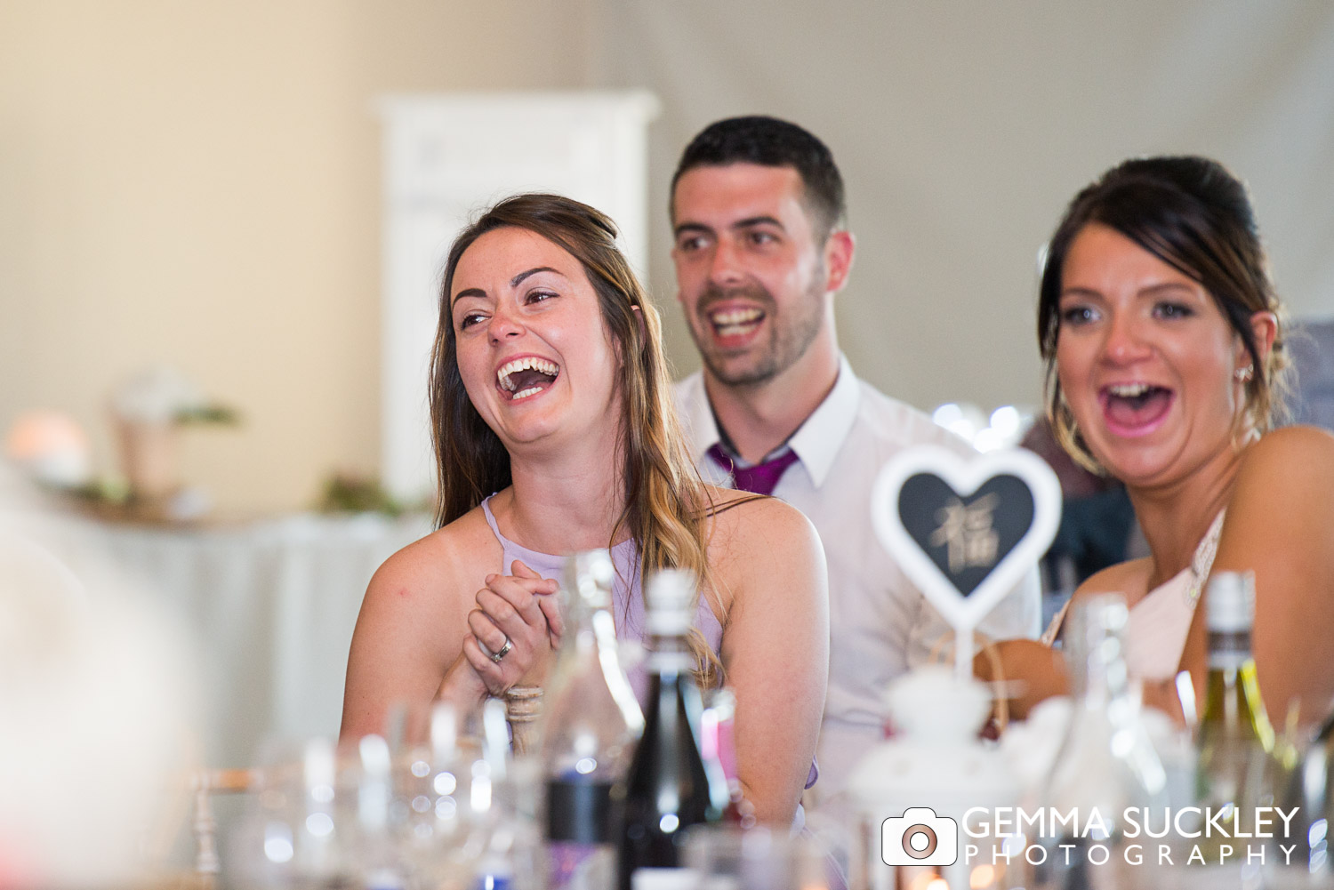Wedding guest laughing at speeched at The Moorlands Inn, Halifax