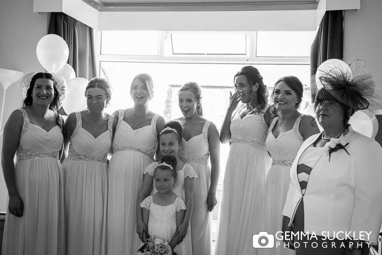 Bridesmaids-reacting-to-seiing-the-bride.JPG