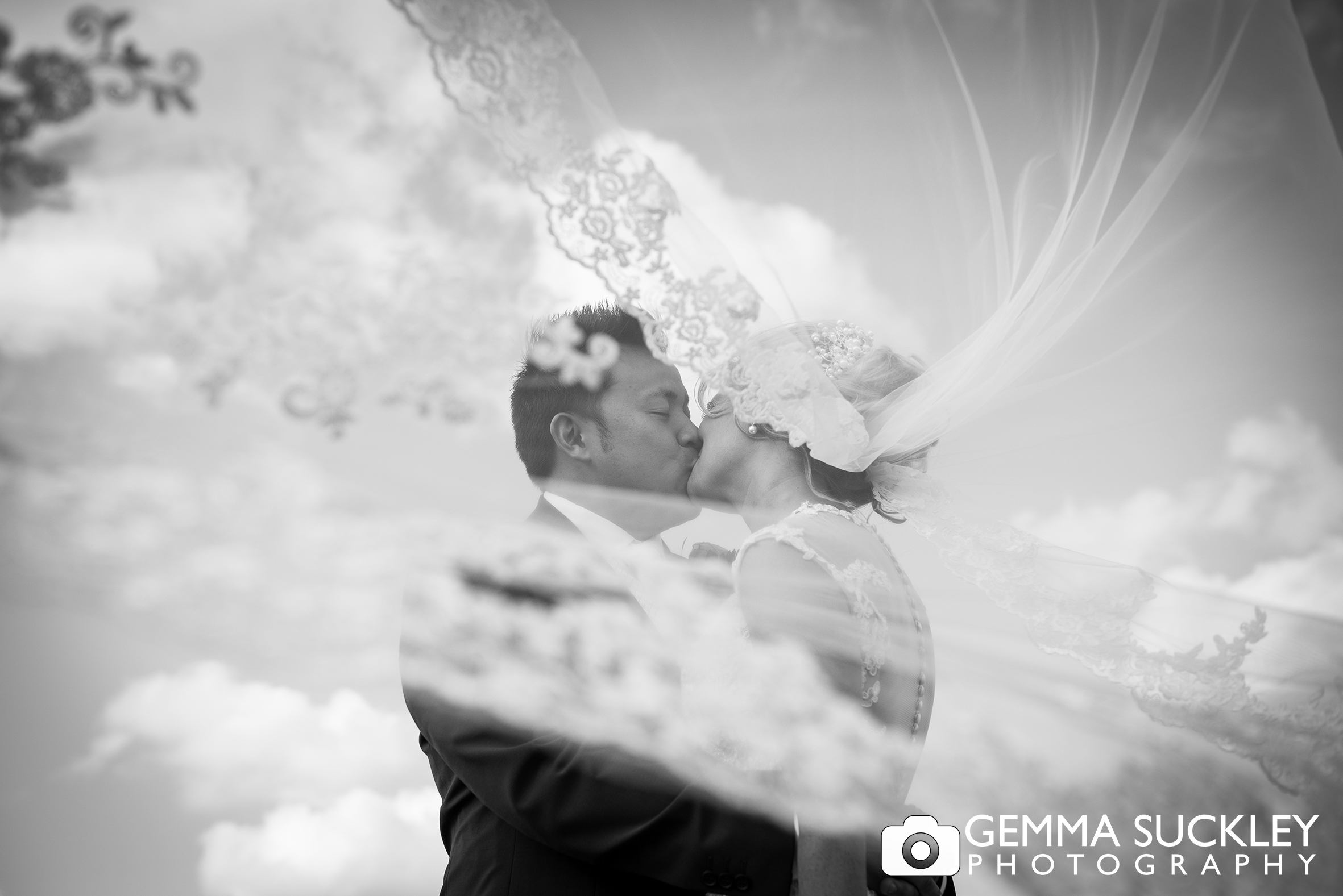 black and white wedding photography of the bride and groom