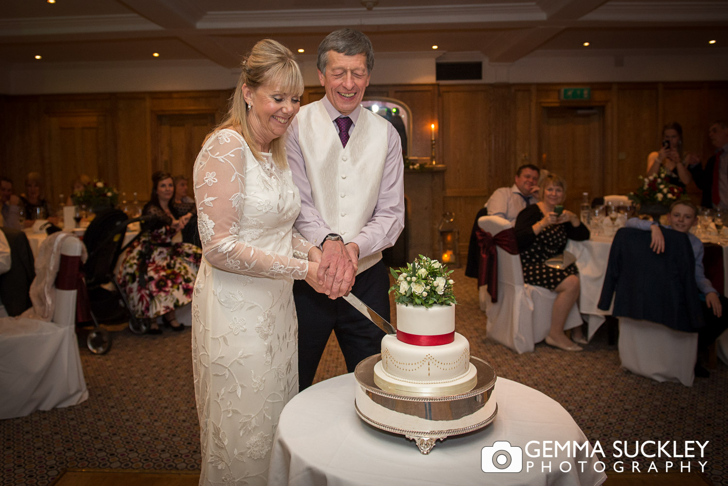 bride and groom cutting the cake wedding cake at Devonshire Arms
